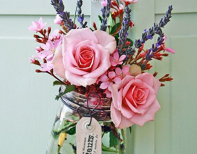 Pretty pink roses bouquet in a mason jar