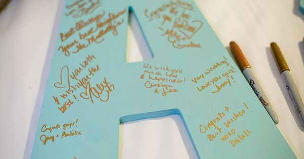 Have guests write their well wishes on large wooden initials. What a fun idea! /// Photo by Gray Photography via Project Wedding (nice small guest book for bridal shower)