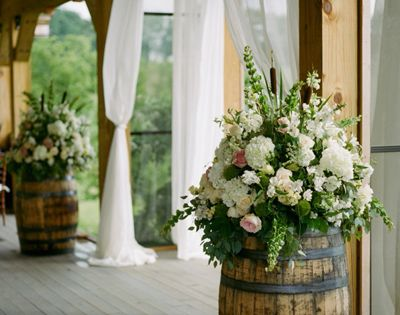 Rustic Wedding Idea: wine barrels with opulent bouquets - Pink Barn Wedding by Kristin Sweeting - Southern Weddings Magazine( Chelsea I have 1 whiskey barrel)