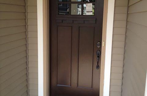 Craftsman fiberglass front door want to stain our front door just like this with the cream trim - Black craftsman front door ...