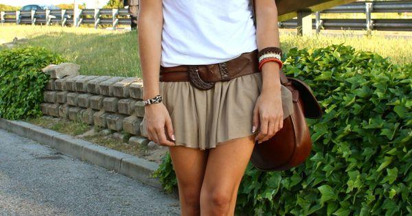 Khaki mini skirt or shorts, white tshirt, leather bag and belt, cowboy