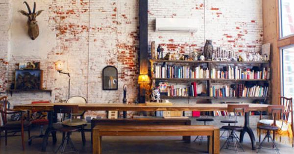 the long table. all the different chairs. the benches. the exposed brick