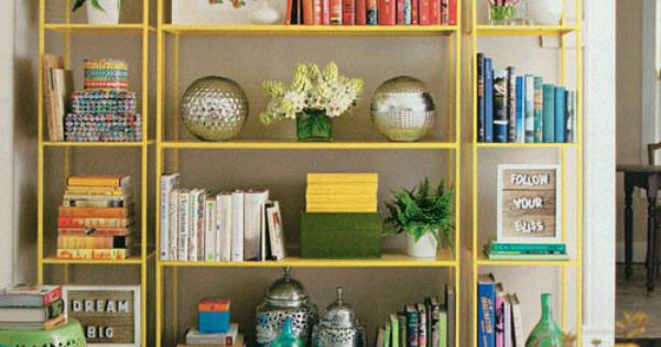 Living room open shelving that's sunny yellow and oh so stylish! Happy