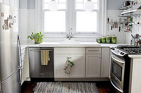 Galley kitchen with white cabinets and dark stained wide for Kitchen cabinets 50cm wide