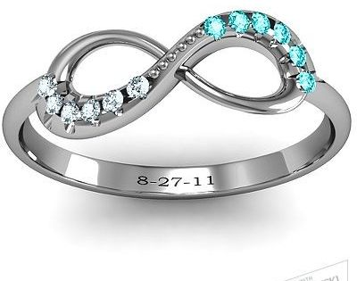 Infinity Ring with his and hers birthstones, and engraved anniversary. Would be