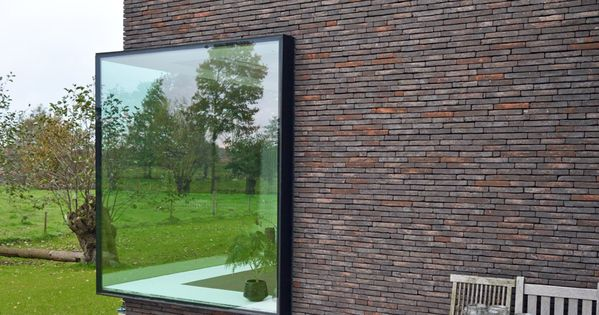 Belgian house with large protruding windows which provide wide ledges for display ceramics - The house with protruding windows ...