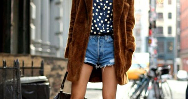 polka dot blouse, faux fur coat, and cut-offs make for a great