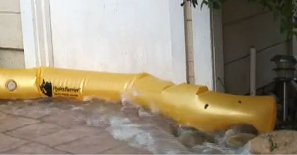 HydraBarrier in action - diverting water from a doorway. | Rainy day ...