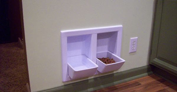 neat idea- built in dog bowls. Much nicer than bowls on the floor. They are removable for washing. They fold up when not in use and can be painted to match your wall color.