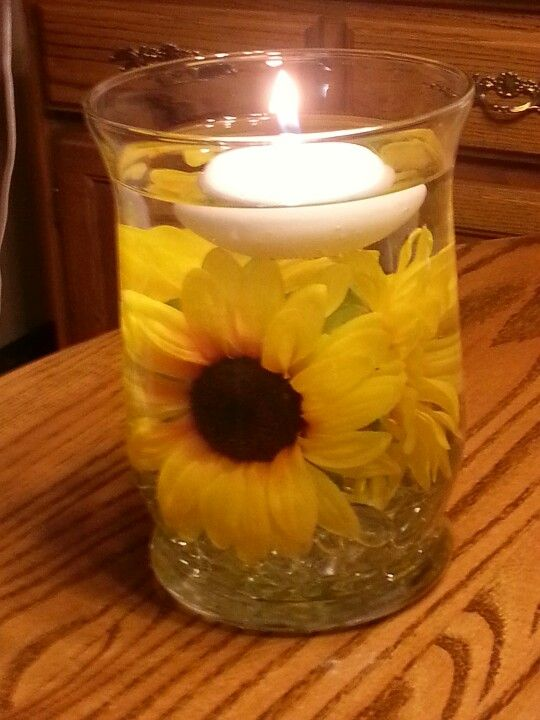 Centerpiece idea marbles on the bottom with a sunflower and centerpiece idea marbles on the bottom with a sunflower and floating candles on top candle wedding centerpieces pinterest floating candles junglespirit Images