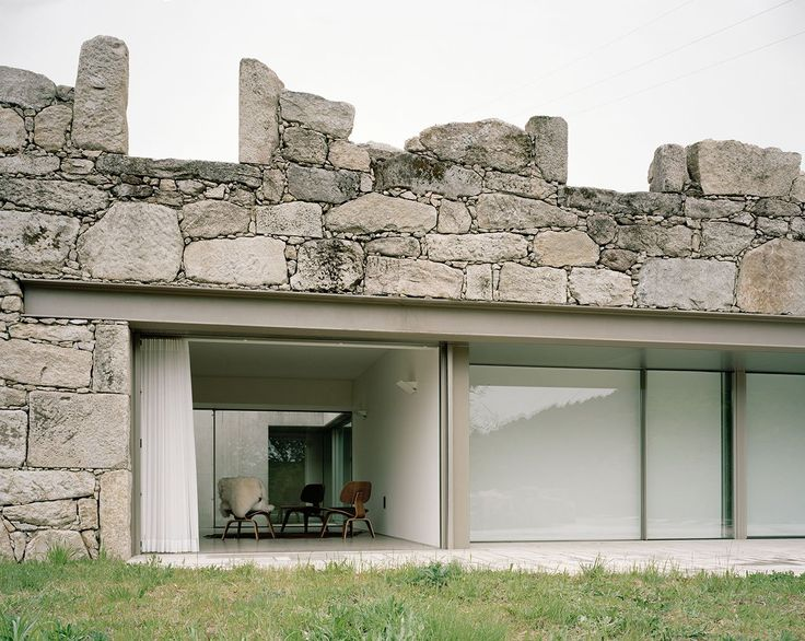 Contemporary stone house rises from old ruins in Portugal - Curbed