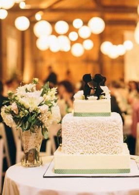 Wedding cake with silhouette couple as topper.