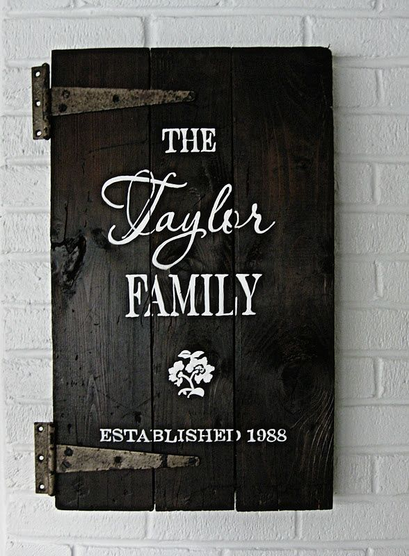 family sign made out of old cabinet door