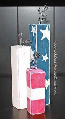 Patriotic blocks. I find decorating more abundantly for the summer holidays helps to keep me from dreading the heat sickness and bug bites and wasp stings and sun burns that come with summer. This looks like it could withstand staying on the porch....djg