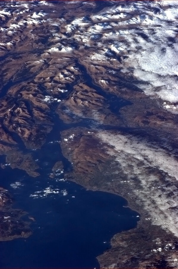 Chris Hadfield -   The ruggedness of Scotland evident in the snowy hills and lochs north of the Firth of Clyde.