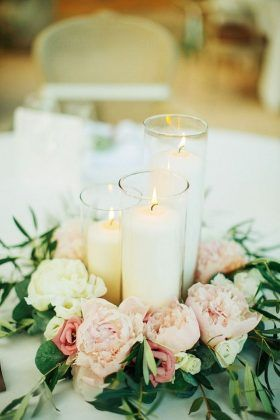simple candle and flowers wedding centerpiece