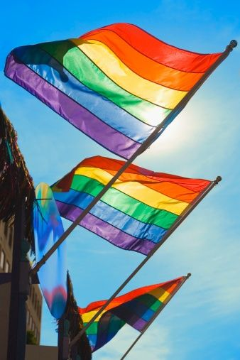 Low angle view of three gay pride flags fluttering on a building – LGBT Quotes Gay Pride, Pride Flag, Christopher Street Day, Gay Aesthetic, Rainbow Aesthetic, Love Is, Pride Parade, Lgbt Community, Rainbow Pride