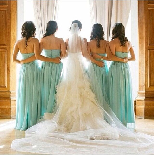 The bridal party in mint dresses