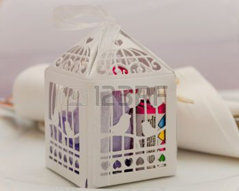 wedding favour: A Paper cage containing wedding favours