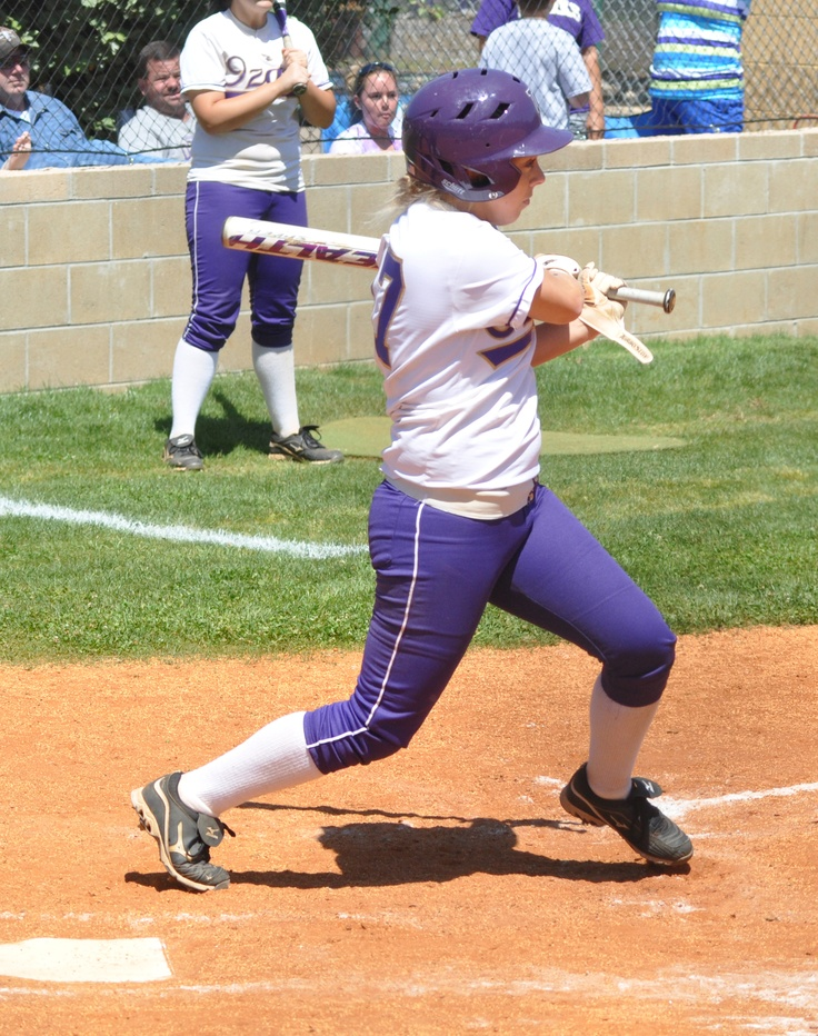 Senior Colbey Russo in one of her final appearances at the plate for Ozarks