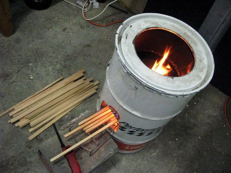 17 best images about what to do with a steel barrel on for Decorative rocket stove