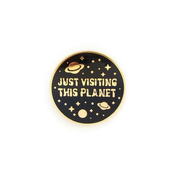 Just Visiting this Planet Space badge enamel pin by Em and Sprout - Soft enamel with rubber backing. - Measures about 1 in.