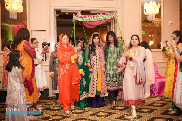 The bride making her entrance into her mehndi night for this Pakistani wedding