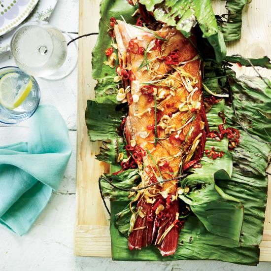 Whole Grilled Fish with Crispy Garlic and Red Chiles | Pete Evans grills whole fish in banana leaves with soy, sherry and ginger.