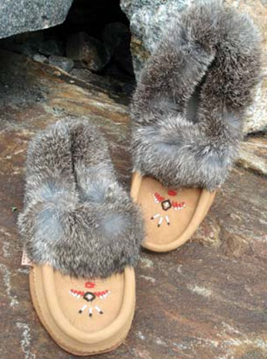 These moccasins are as comfortable as they look. The synthetic fleece lining will keep your feet warm all winter while providing a cushion while you walk. An extra layer of moosehide on the sole adds durability and the beadwork and rabbit fur trim combine for a great look. Recommended for indoor wear only.