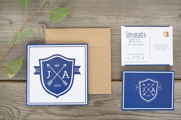 crest motif invitations - photo by Katrina Louise - http://ruffledblog.com/secluded-garden-estate-wedding/