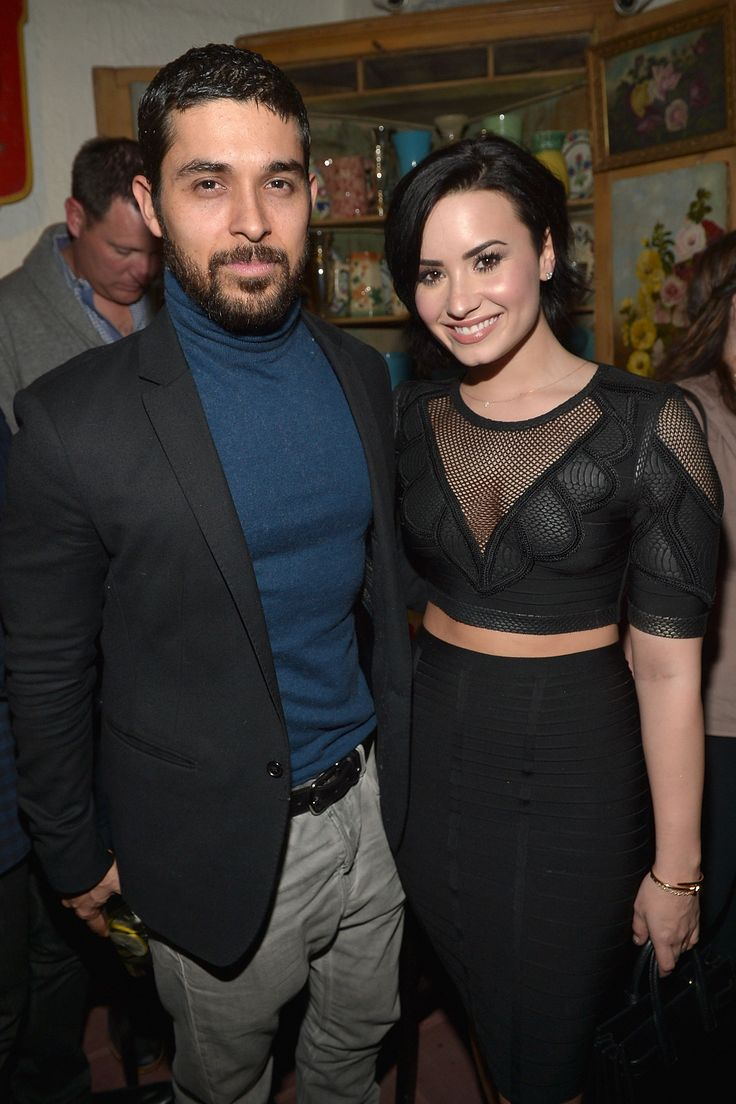 """Wilmer Valderrama and Demi Lovato celebrate Nick Jonas's song """"Jealous"""" being the #1 at Top 40 radio hit Jan. 20, 2015, in Los Angeles.   Getty -Cosmopolitan.com"""