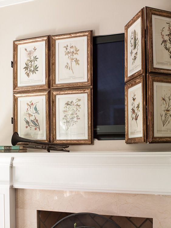 Art panels to hide TV on hinges are a great way to mask the TV that is hung over the fireplace...
