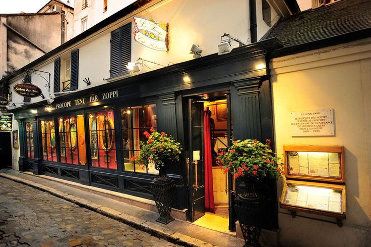 Le Procope - Oldest café/restaurant in Paris. Voltaire used to hang out there! It's still a fully functioning café and restaurant, decorated to match its origins. Also, Voltaire was known to drink 70 cups of coffee a day