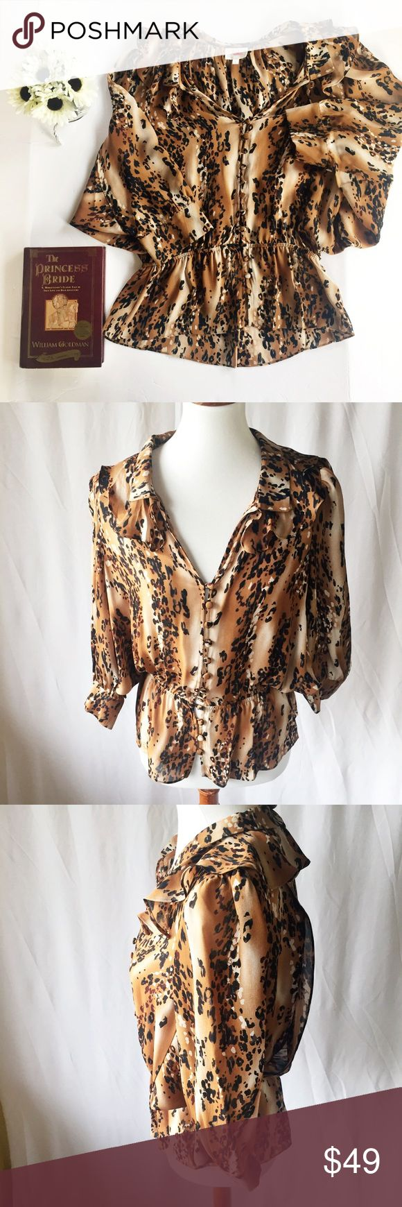 """Parker Animal Print Silk Ruffle Blouse Small Parker created this animal print blouse with silk ruffles. Buttons down the front with an elastic waist. Batwing sleeves. V-neck. Fun, flirty, and flattering.  Fabric: 100% Silk  Approximate measurements:   Size: Small Length: 23"""" Chest: 34""""  Condition: Excellent Used Condition (EUC) - no flaws, no signs of wear Parker Tops Blouses"""