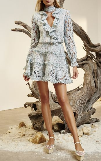 The designer: Alexis Barbara Isaias is known for her enviable party dresses.    This season it's about: Feminine florals and voluminous sleeves, plus the brand's signature halter necklines and jumpsuits.    The piece to buy: A flirty tiered floral mini dress.
