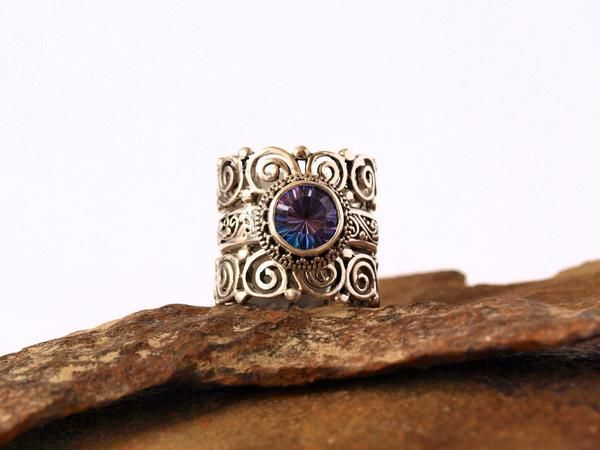"This ring is a conversation piece.  It is simply stunning!  Beautiful purple mystic topaz onyx and sterling silver ring.  This ring is 3/4"" wide all the way around.  Detailed and gorgeous.  This ring is a size 8.  I find that these rings are sized small, order 1 size up."