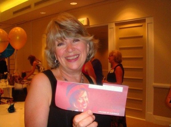 Former Ansett Air Hostess Gerri O'Keefe with her photo on the airline ticket from the 70s