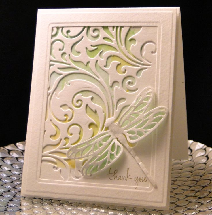 Thank You 2017 M&K Tim Holtz mixed media die over water colored paper framed with Spellbinder dies. SU dragonfly, backed with vellum, colored on back, with Stardust Stickles on top of vellum, which you cannot see in this photo. 90 lb Water color paper used for card base and frame. A4 size Created by Peggy Dollar