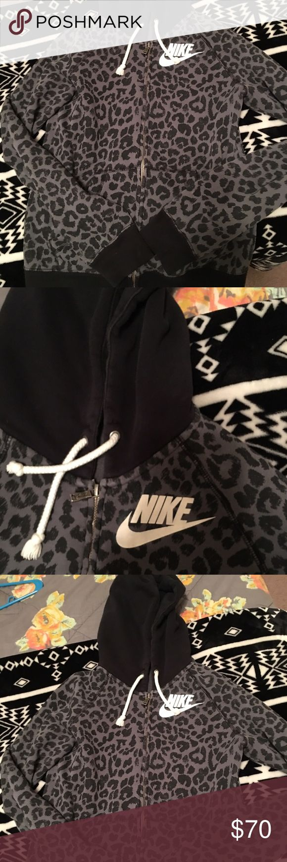 XS HTF rare Nike Leopard Full Zip XS NWOT Nike leopard full zip hoodie. This is an extremely rare piece. Will trade for other XS Nike rally collection, Nike rally sweats or skinny leggings, XS rare vs pink, vs Pink Patriots  or Nike patriots gear. Not selling ATM Nike Tops Sweatshirts & Hoodies
