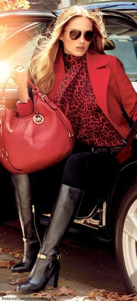 Karmen P. is carrying my fav Red handbag by Michael Kors. Love it! Can she not get out of the car?.......................