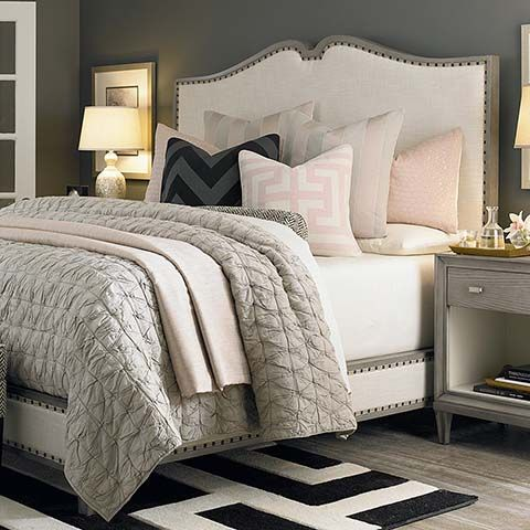 Love this white and gray tufted headboard and gray side tables