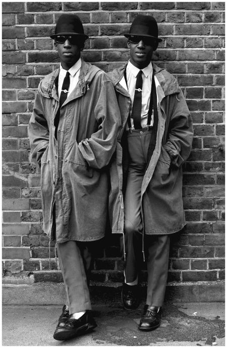 """Photo Janette Beckman The Islington Twins In London, 1979 """"These two identical twin guys, Chuka and Dubem, were literally standing outside the toilet in the schoolyard. They were so well-dressed to go to school. They later became known as the Islington twins and this picture even got to be in the Victoria and Albert Museum."""