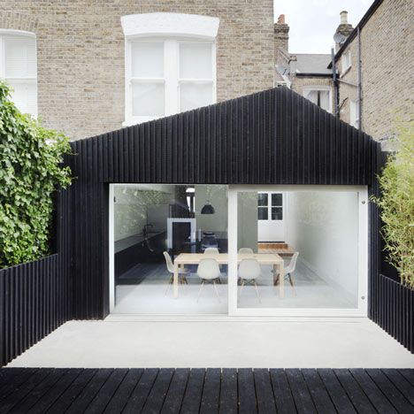 London architects Gundry & Ducker have added a blackened larch extension onto the rear of a Victorian terrace in south London.