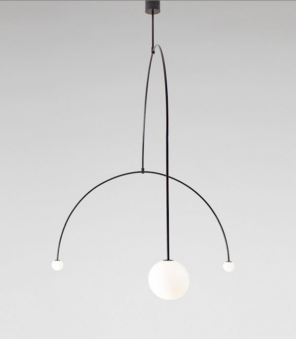 Milan Design Week 2015    Michael Anastassiades debuted a number of new fixtures at this year's Euroluce. Among the most compelling, were the five glass and brass pieces from his Mobile collection.