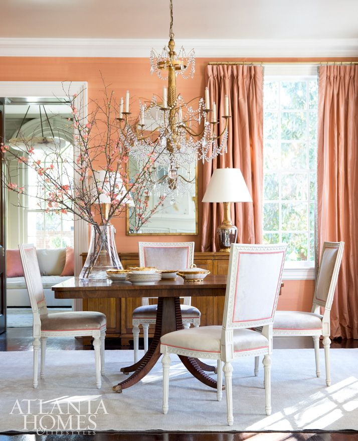 Luscious silk draperies and a spicy metallic wallcovering sparkle in the dining room thanks to a Paul Ferrante chandelier. Table, Dessin Fournir.