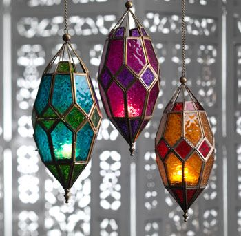 Large Moroccan style iron hanging lantern with two-tone patterned glass panes and an antique gold coloured finish, made on a fair trade basis.