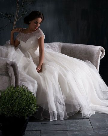 LORELEI - A soft ball gown, with corseted bodice and layers and layers of silk organza in the skirt. The jacket of ultra fine French lace and ruched silk waistband, is completely detachable revealing a classic gown with lace detail at the waist. This allows for completely different looks from day to evening.