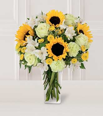 Get Well Flowers - FTD Sunset Bouquet  - PREMIUM - Two gorgeous sunflowers captivate this bouquet.  Along with golden yellow button poms, pistachio carnations, jade roses and ivory alstroemeria, its sure to light up your recipients face - and heart!