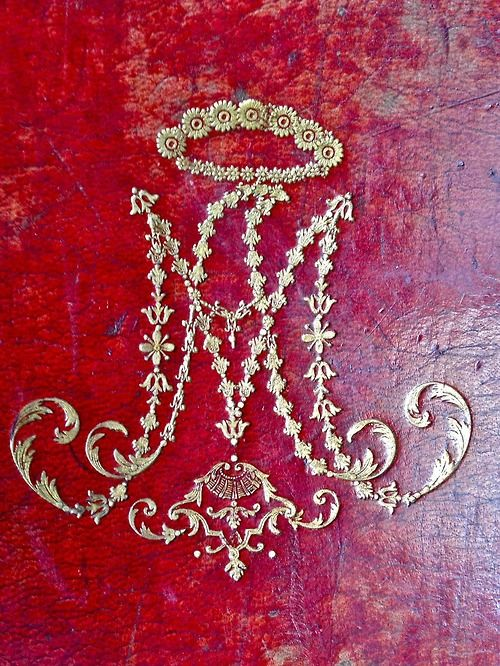 audreylovesparis:  This cypher of Marie Antoinette adorns the cover of her Prayer Book.
