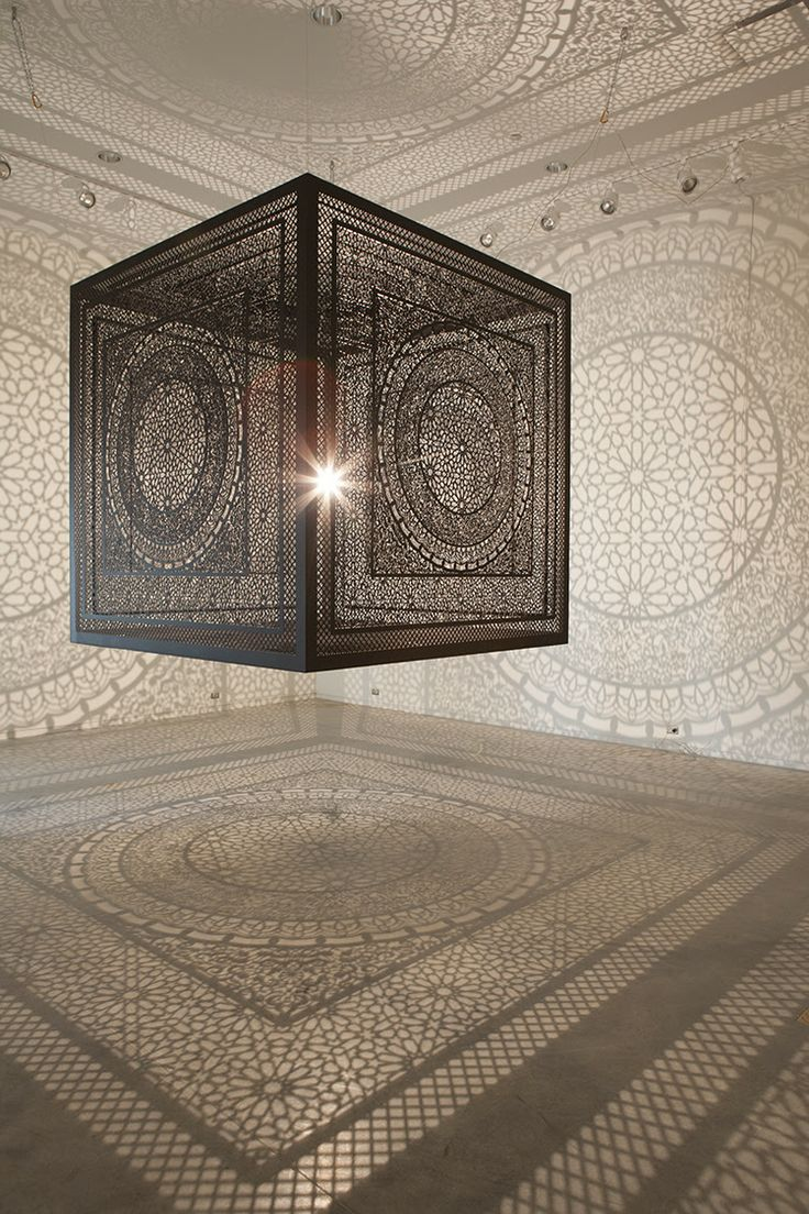 Created by mixed media artist Anila Quayyum Agha, this elaborately carved cube with an embedded light source projects a dazzling pattern of shadows onto the surrounding gallery walls. Titled Intersections, the installation is made from large panels of laser-cut wood meant to emulate the geometrical patters found in Islamic sacred spaces.